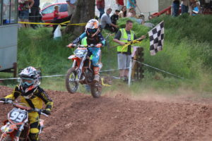 Junior action with Morgan Evans taking the chequers (2)